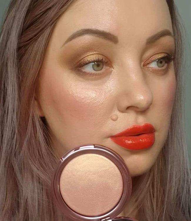 Pat McGrath Divine Rose Ultra Glow Highlighter Makeup on the cheeks